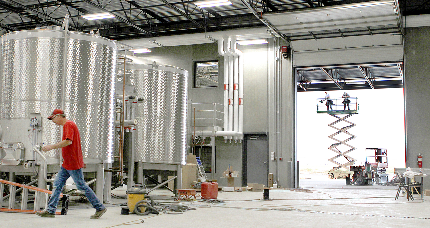 A flurry of activity continues during construction at Double Canyon Winery in West Richland. The 47,000-square-foot winemaking facility opened in September. The $6 million facility has the capacity to make 50,000 cases of wine. (Photo: Paul T. Erickson)