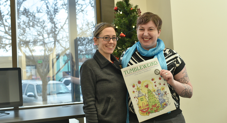 "Sarah Bray, left, and Sara Quinn, editor-in-chief of Tumbleweird, show off the December issue. Bray and Adam Brault recently became publishers and owners of the two-year-old ""positively weird"" monthly publication."