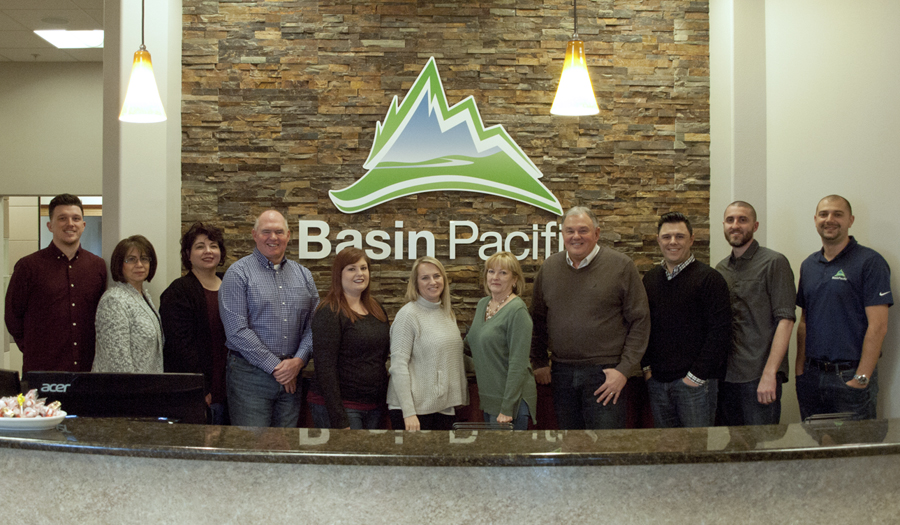 The Basin Pacific Insurance and Benefits team stand behind the front desk at its new location at 6917 W. Grandridge Blvd., Unit 1, in Kennewick. The Kennewick branch of the Moses Lake-based company originally opened in 2010.