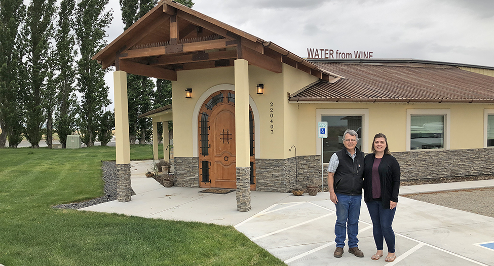 Pat Tucker and his daughter Jamie Ssenkubuge stand outside their Paterson tasting room for their nonprofit Water from Wine, which donates wine sale profits to organizations working to bring clean water to communities around the world. (Courtesy Jamie Ssenkubuge/Water from Wine)