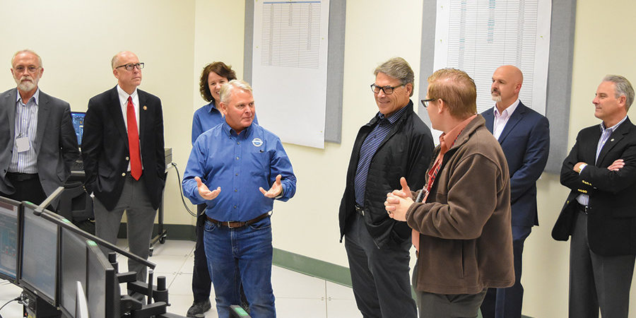 U.S. Rep. Dan Newhouse, R-Sunnyside, left, invited Jennifer Granholm, the new Energy secretary, to tour the Hanford site, continuing his tradition of hosting senior officials in Richland. Above, he welcomed former secretary Rick Perry, center in dark jacket, in August 2017. Perry was former President Donald Trump's first Energy secretary. (Courtesy Bechtel National Inc.)